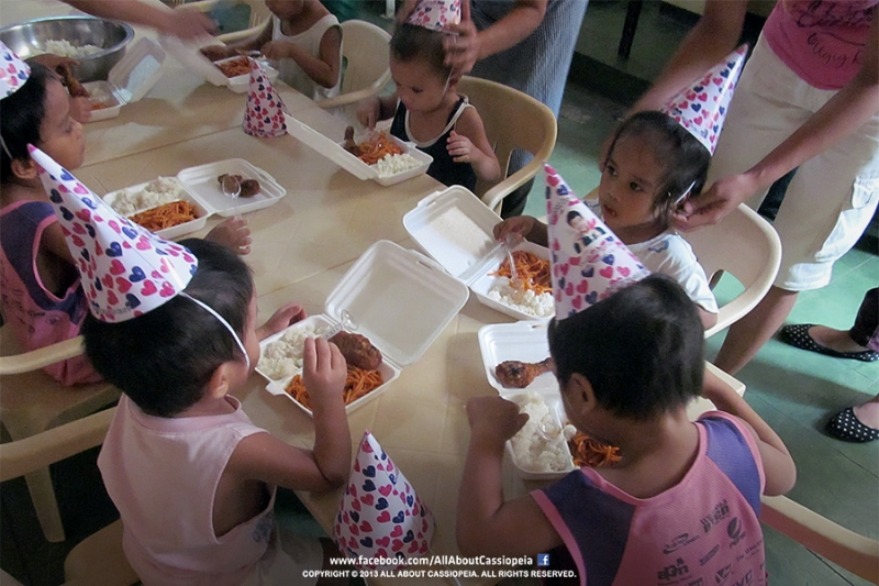 The children enjoying their lunch together with their Yoochun Birthday hat!