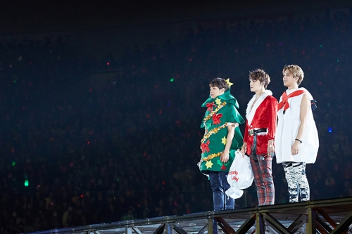 JYJ on stage in their various Christmas costumes in Fukuoka. Photo: C-JeS Entertainment.