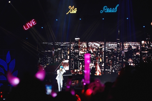 "XIA performing ""Reach"" in Shanghai. Photo: C-JeS Entertainment."