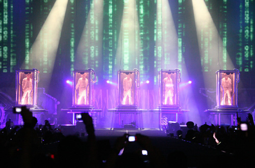 TVXQ! in glass capsules during the opening sequence in Kuala Lumpur. Photo: S.M. Entertainment.